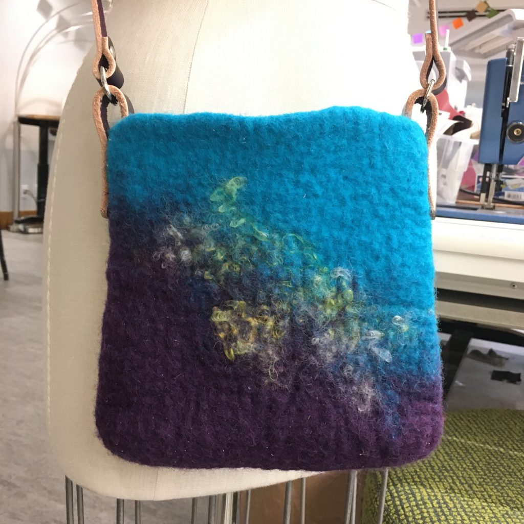 felted wool handbag in turquoise and amethyst colors